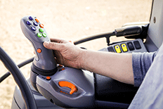 Man using guidance steering on a piece of agricultural equipment