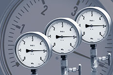Three air compressor gauges next to each other with a gauge screen as the background image