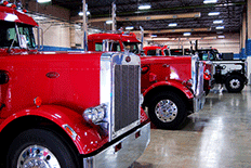 Garage filled with red semi trucks