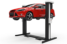 Red sedan in the air on an automotive hydraulic lift