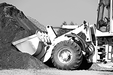 Black and white image of an earth mover during operation