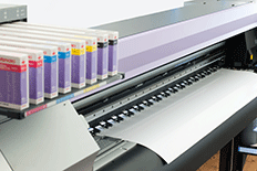 Color image of a large format printer with several ink cartridges