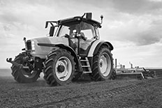 First Western Equipment Finance - Black and White Photo of Agricultural Plow Equipment